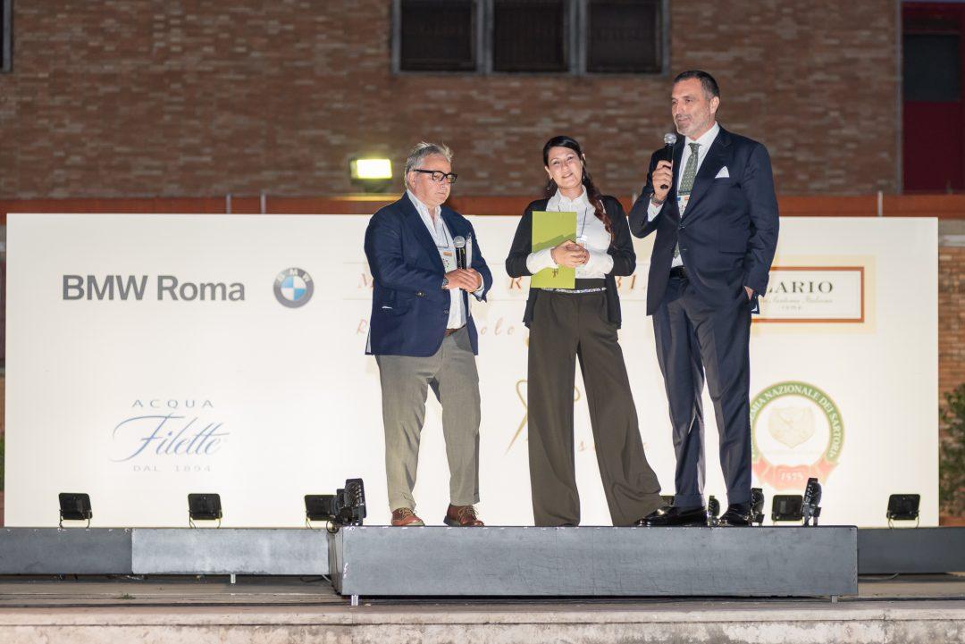 Gli abito del progetto Made in Rebibbia in sfilata all'interno dell'istituto penitenziario. Un progetto sostenuto da BMW Roma.